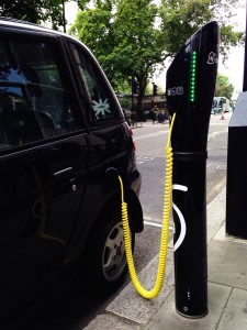 A photograph of a car being charged at an electric charing point in London.