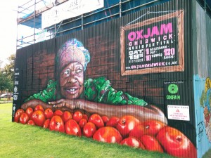 Painted hoarding promoting Oxjam Chiswick music festival in London.