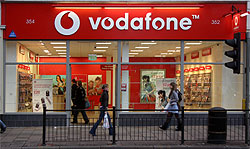 A photograph of the outside of a Vodafone shop.